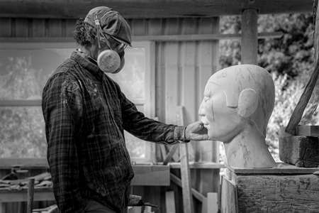 William Peers carving one of the marble heads